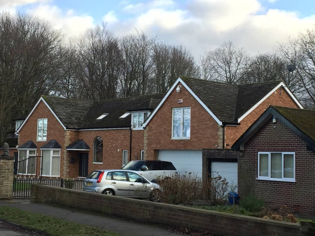 After brick cladding and stone corners