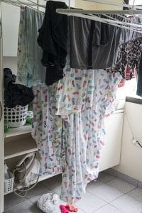 Drying clothes inside the home can cause damp
