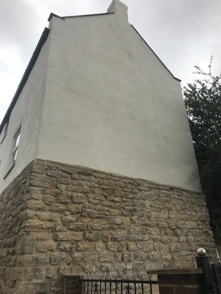 Lime render lime pointing to stone